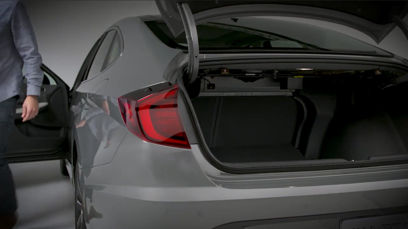 elantra trunk opens by itself
